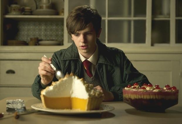 A still from Toast movie of Freddie Highmore eating lemon meringue pie.