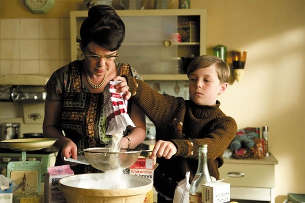Still from Toast the movie of Nigel cooking with his mum in their kitchen.