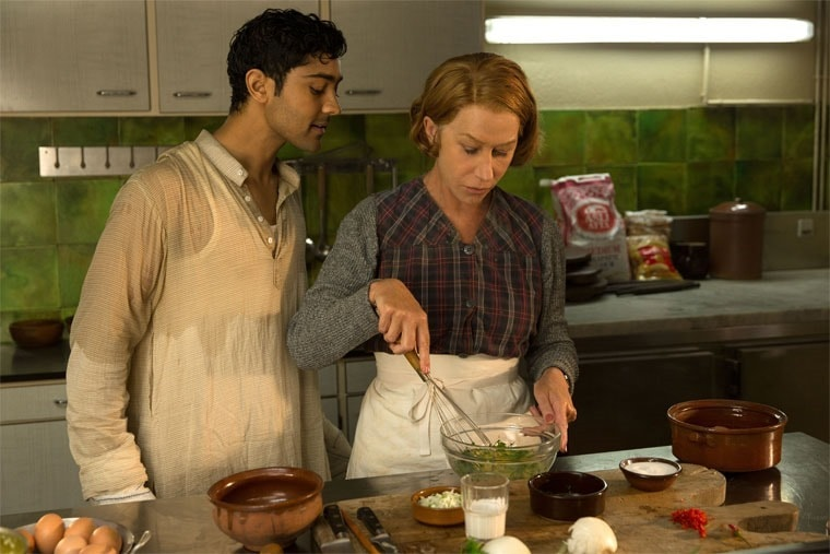 Helen Mirren and Manish Dayal cook in The Hundred-Foot Journey. Read more about the movie at This Mama Cooks! On a Diet - thismamacooks.com