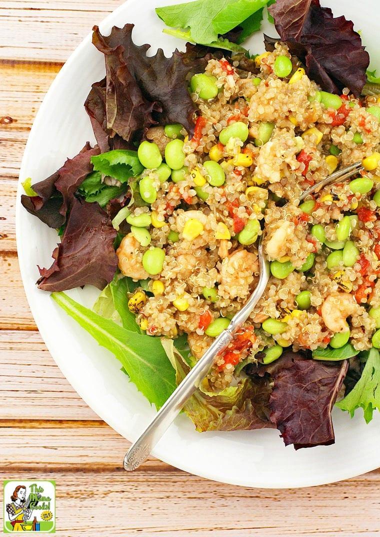 Closeup of quinoa, edamame, and shrimp salad with fork.