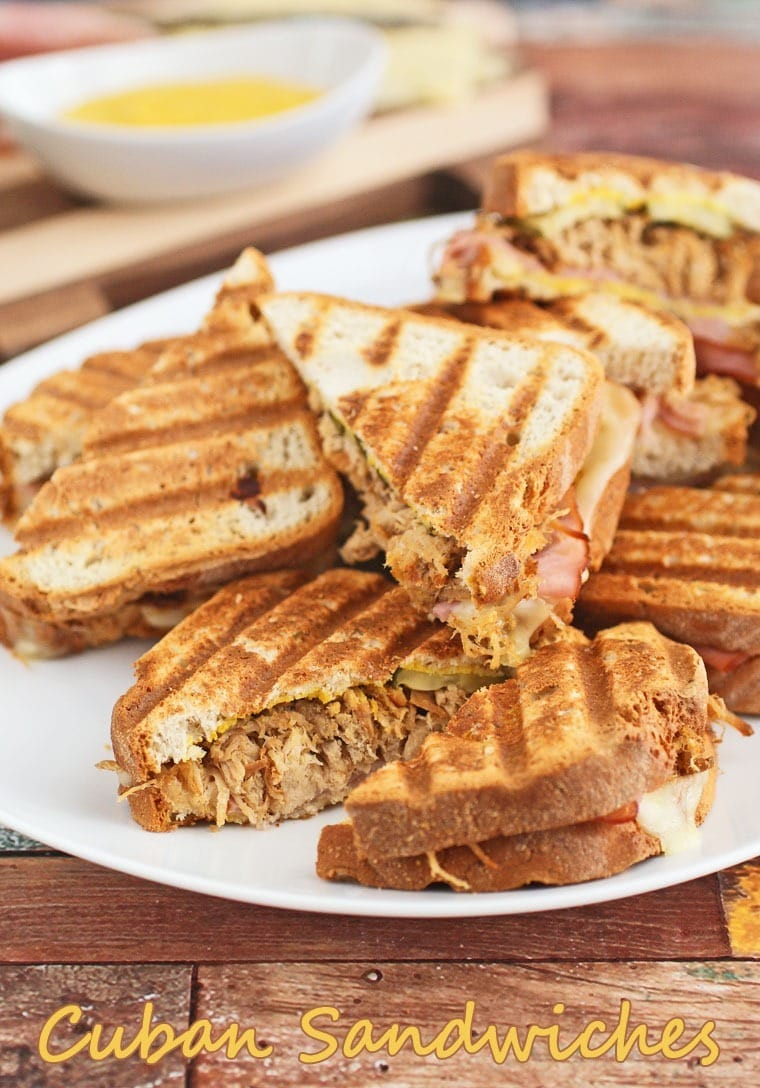 Easy to make grilled Cuban Sandwiches with slow cooker pulled pork. Get the recipe at This Mama Cooks! On a Diet - thismamacooks.com