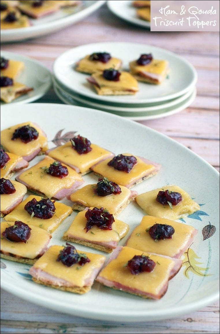 Ham & Gouda Triscuit Topper appetizers are a great way to use up leftover ham and cranberry sauce. Try this appetizer recipe with leftover turkey instead of ham. #partyfood #appetizers #appetizerrecipes #cranberries #cheese #ham #easyrecipes