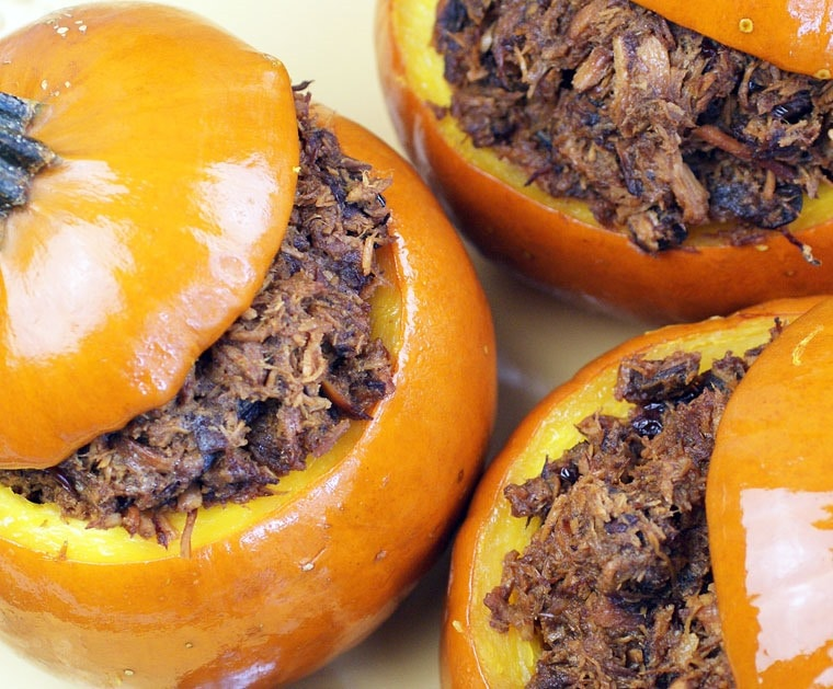 Don't want turkey this Thanksgiving? Make Slow Cooker Cranberry Pulled Pork in Sugar Pumpkins instead! You can make this slow cooker recipe for holiday parties as well. Get this easy slow cooker recipe at This Mama Cooks! On a Diet