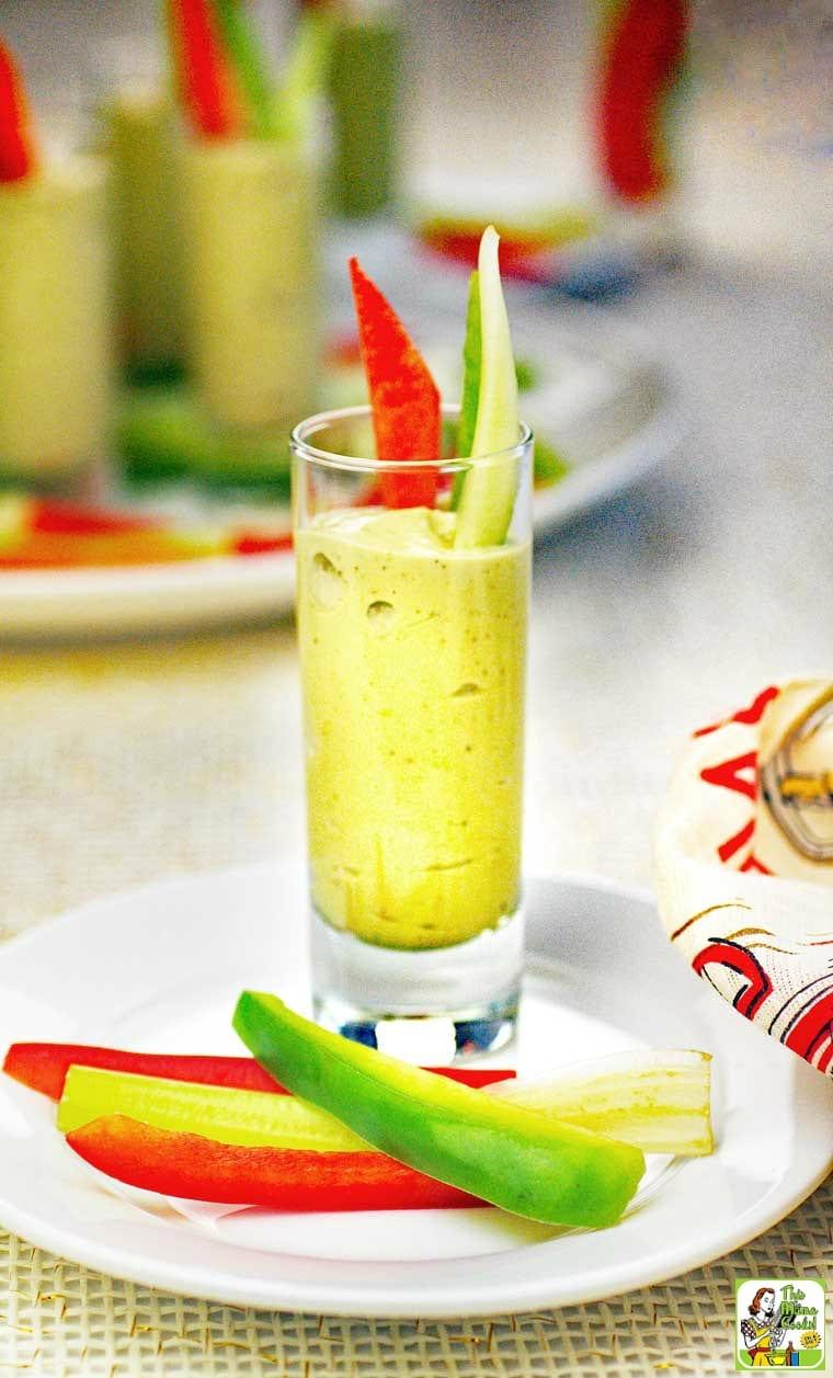 An Avocado Dip Veggie Shooter appetizer with sliced vegetables.