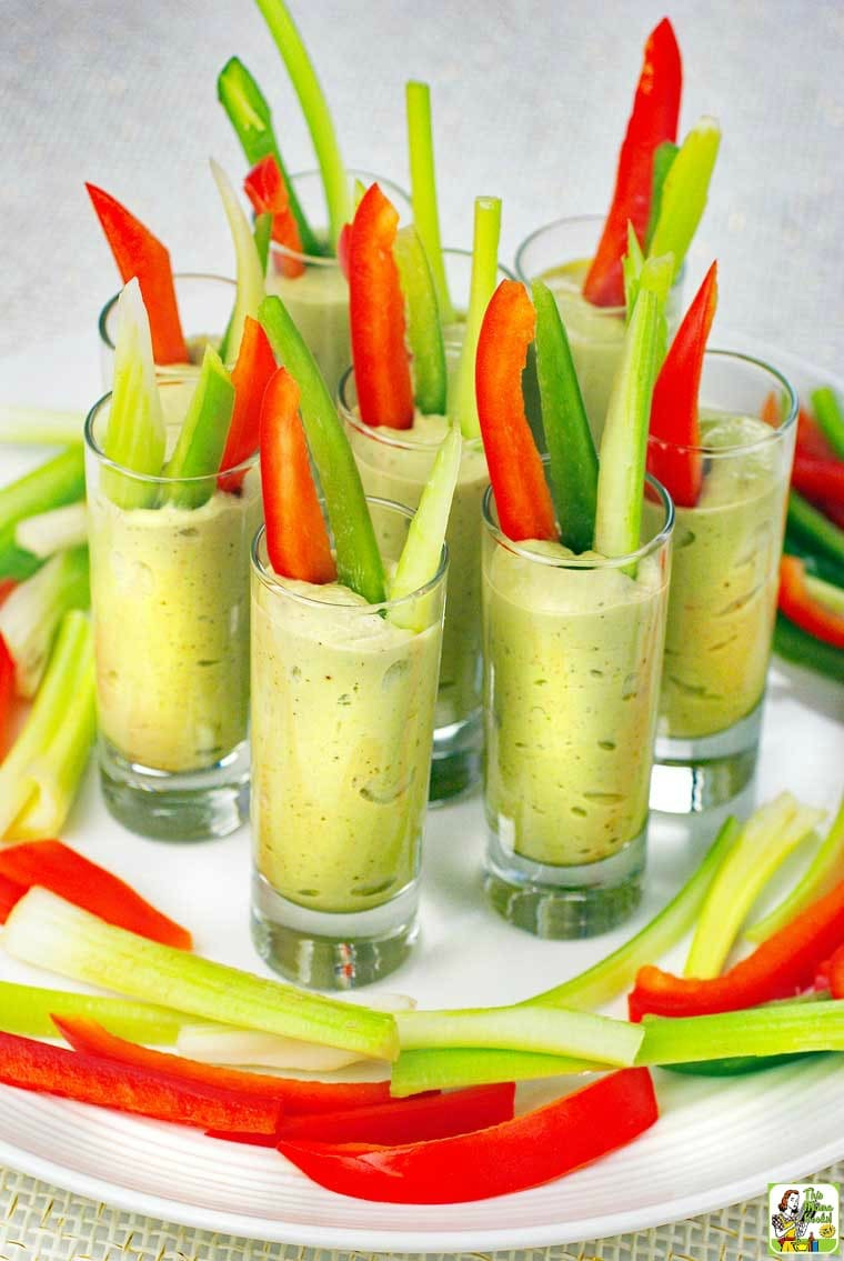 A tray of Avocado Dip Veggie Shooters with sliced vegetables.