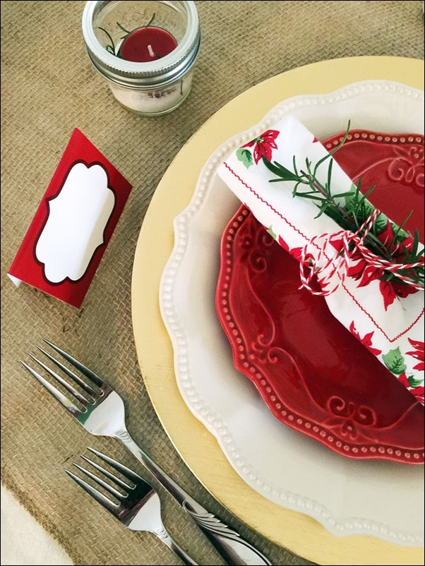Mix and match your holiday dishware. Use rosemary from the garden, Mason jars from the kitchen and twine from your craft table. Get more easy holiday decorating tips at This Mama Cooks! On a Diet