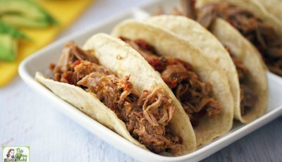 Need a recipe for Taco Tuesday or Family Taco Night? Try this Best Slow Cooker Spicy Pulled Pork Tacos recipe. Super easy Mexican pulled pork crock-pot recipe and great for parties, too!