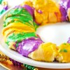 Need a King Cake recipe for your Mardi Gras party? Try a healthier and easy to make Mardi Gras Kings Cake recipe with Cream Cheese Cinnamon Filling!