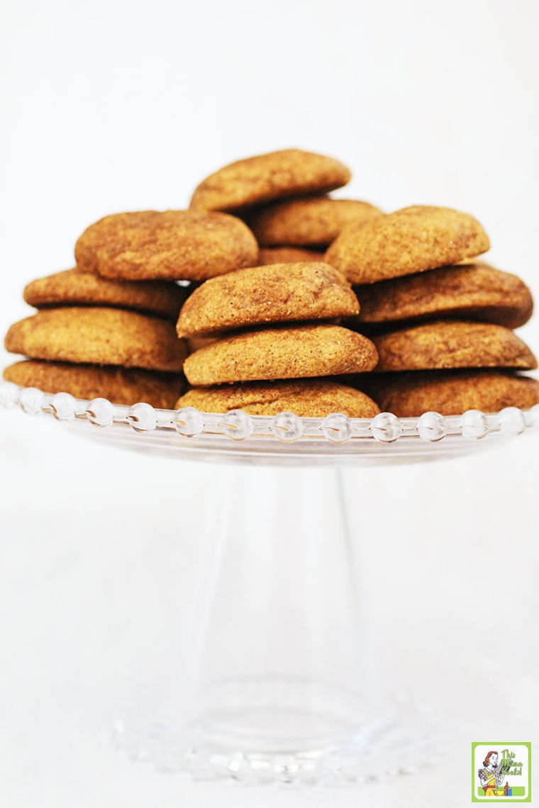 A stack of Gluten Free Snickerdoole Cookies on a glass cake stand.
