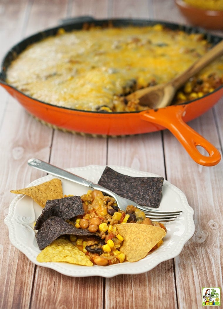 A plate and skillet of Easy Nachos and tortilla chips.