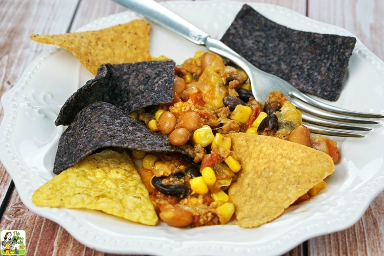 A plate of Easy Nachos with chips and a fork.