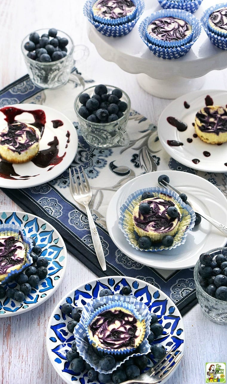 This healthy and Gluten Free Mini Blueberry Swirl Cheesecakes recipe is guilt free because it's made with non-fat Greek yogurt, low fat cream cheese, fresh blueberries, and monk fruit sweetener. It's the perfect gluten free dessert recipe for summer entertaining!
