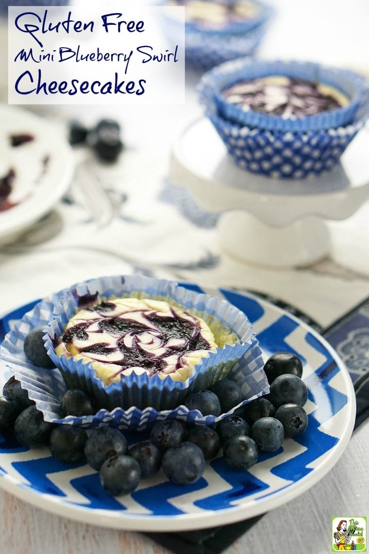 This easy to make Gluten Free Mini Blueberry Swirl Cheesecakes recipe is made with non-fat Greek yogurt and monk fruit powder. This gluten free dessert recipe is perfect for backyard barbecues, Sunday brunches, or potluck parties!