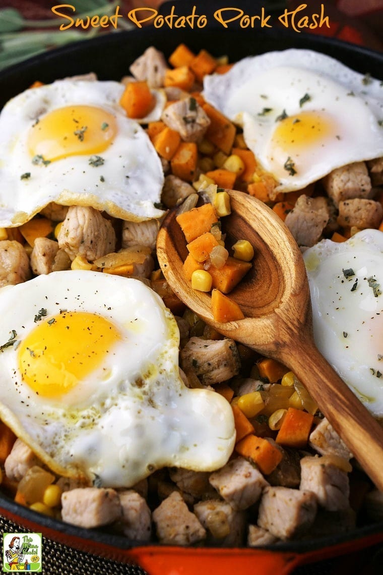 Sweet Potato Pork Hash, sunny side up eggs, and a wooden spoon