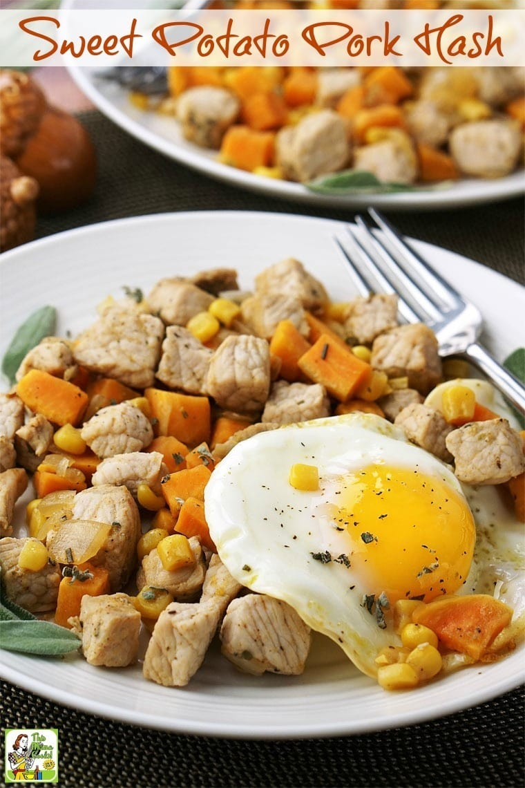 A plate of Sweet Potato Pork Hash with sunny side up eggs, and a fork
