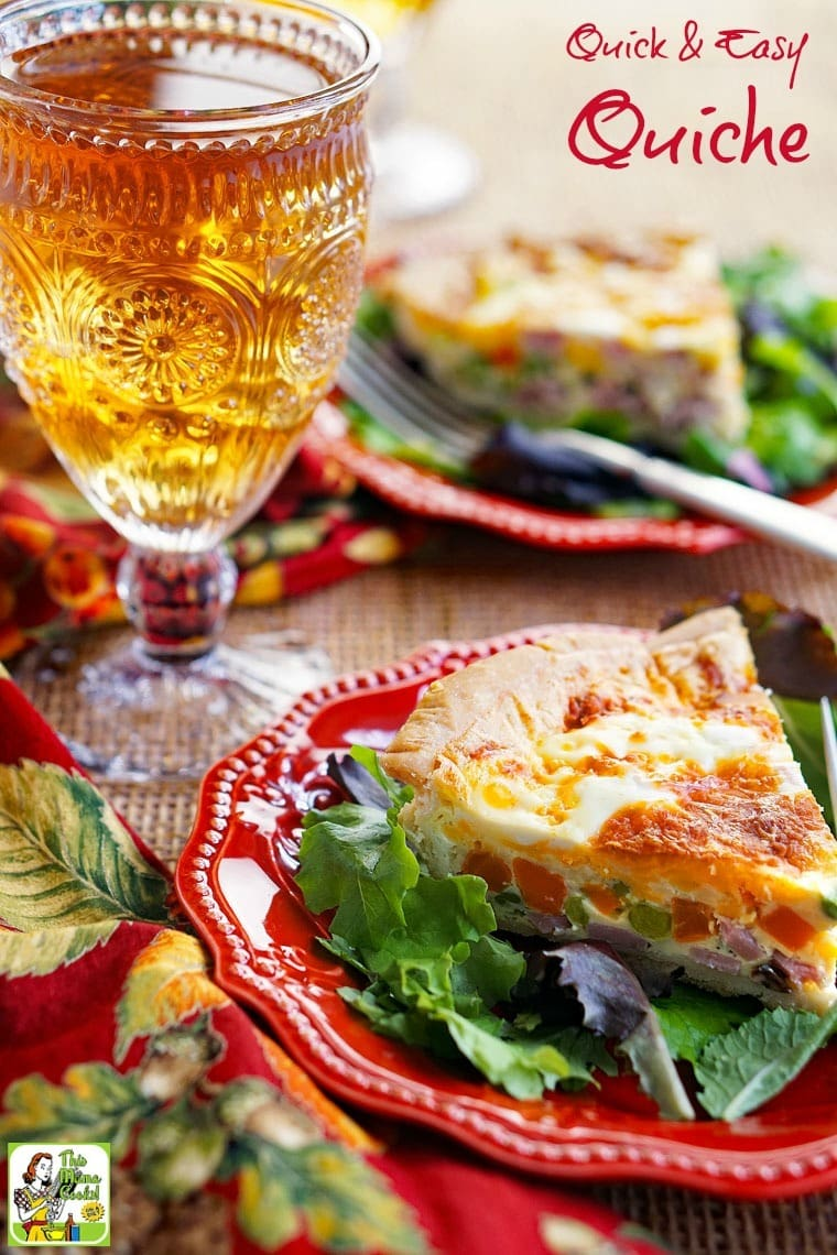 A plate of quiche with a glass of iced tea