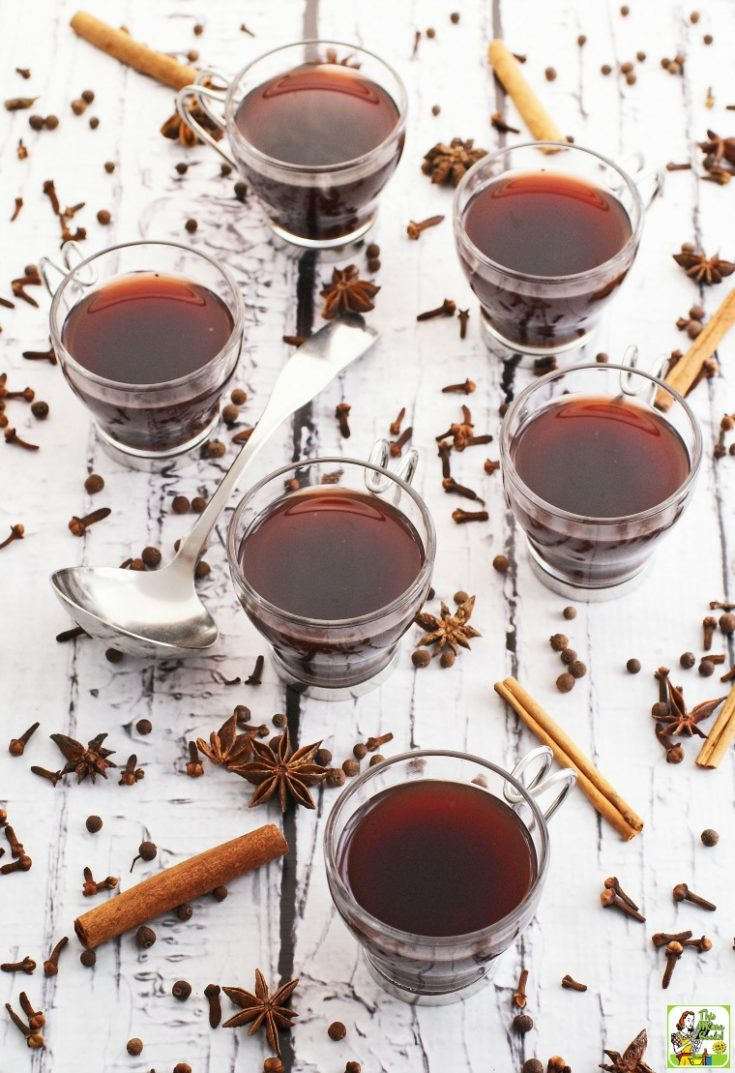 Glasses of Slow Cooker Mulled Wine with spices and ladle.