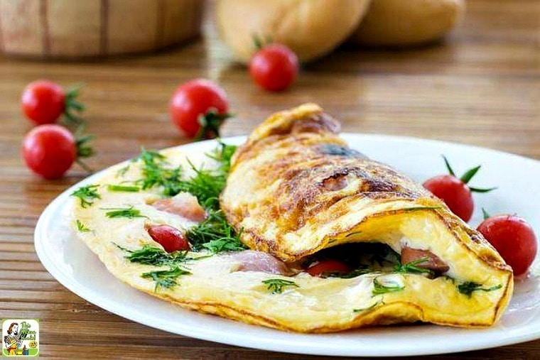 Omelette aux Fines Herbes from The Hundred-Foot Journey on a white plate with tomatoes.