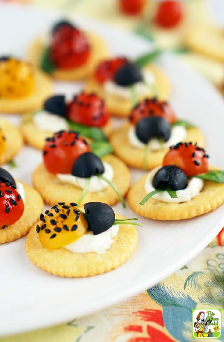 aprese Ladybugs Appetizer on a white plate with floral napkin.