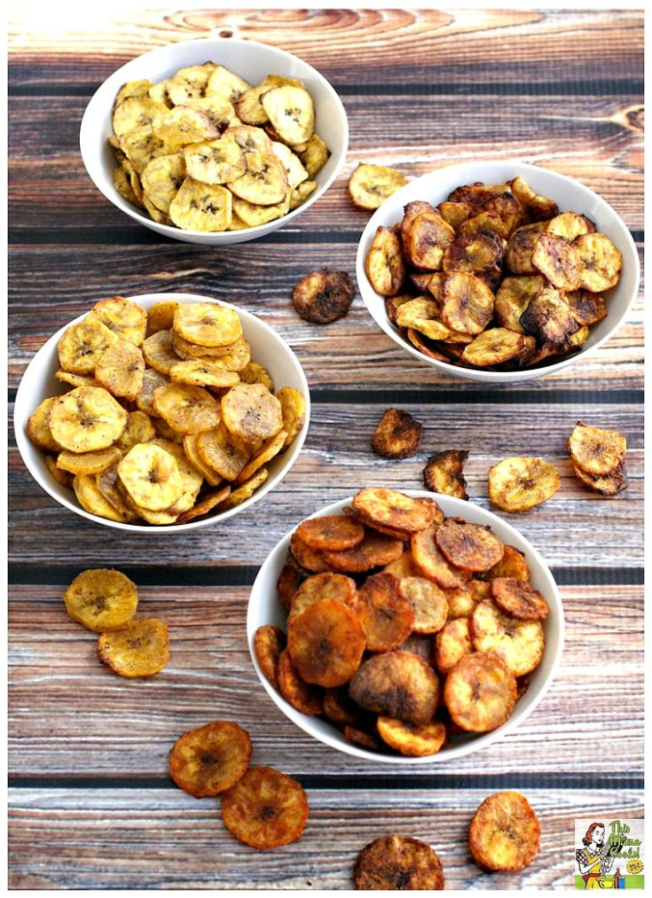 Four white bowls of baked plantain chips flavored four ways.