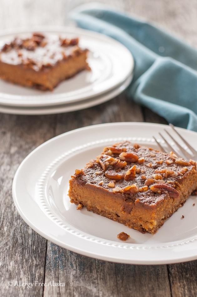 healthy pumpkin desserts: a Gluten Free Dairy Free Pumpkin Pie Bars on a plate with a fork