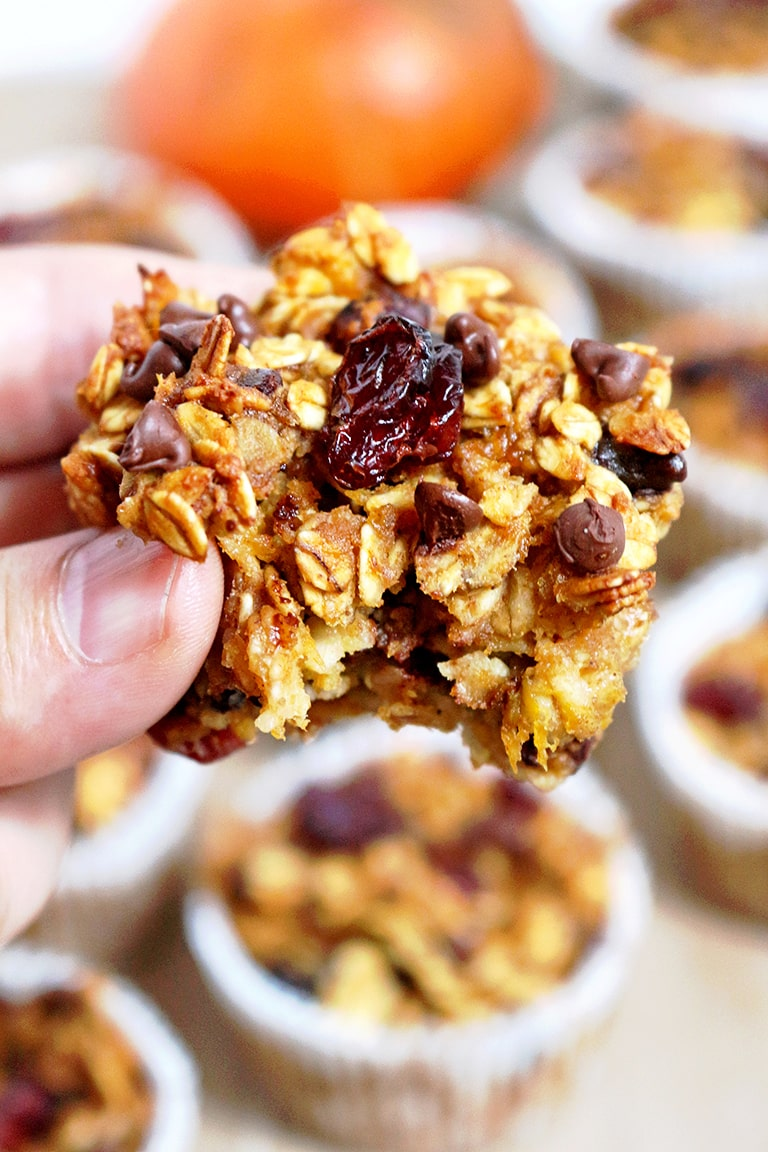 healthy pumpkin muffin recipe: Easy Pumpkin Oatmeal Cups with a bite taken out of it
