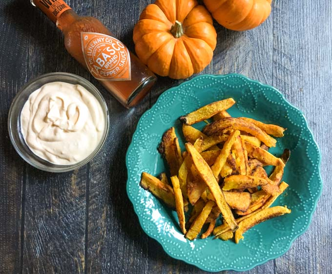healthy pumpkin recipes: a turquoise plate of Pumpkin Fries with Buffalo Aioli in a side dish