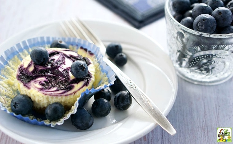 Gluten Free Mini Cheesecake with Blueberry Swirl is a mini cheesecake recipe you'll love baking up!
