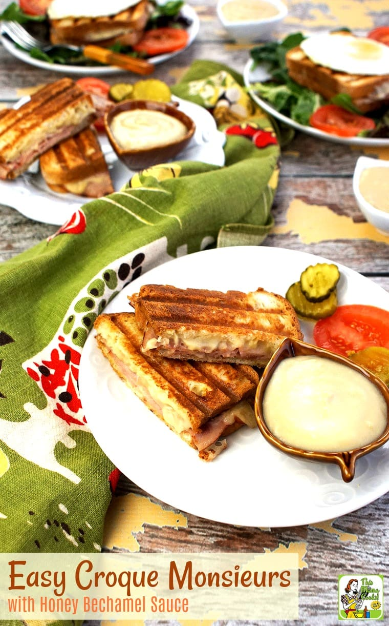 A plate of grilled ham and cheese sandwiches with bechamel sauce.