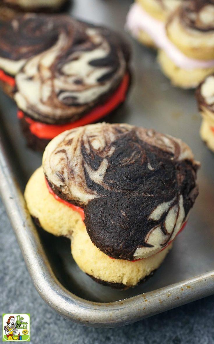 Closeup of chocolate and vanilla cake mix whoopie pies on a baking sheet pan.