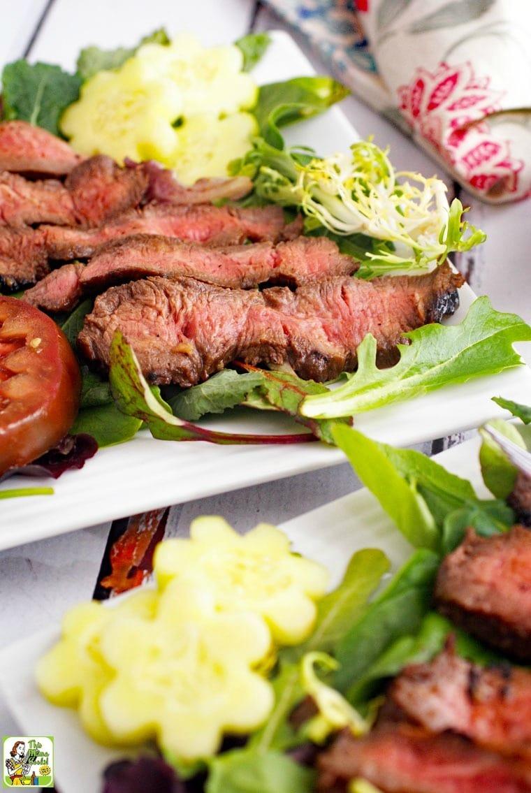 Closeup of plates of Flat Iron Steak Salad with Yogurt Dressing.