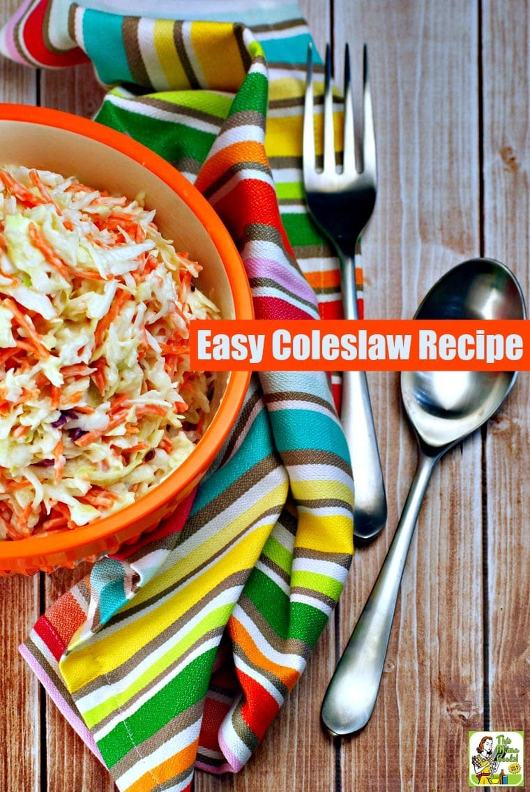 A bowl of coleslaw with striped towel and serving utensils.