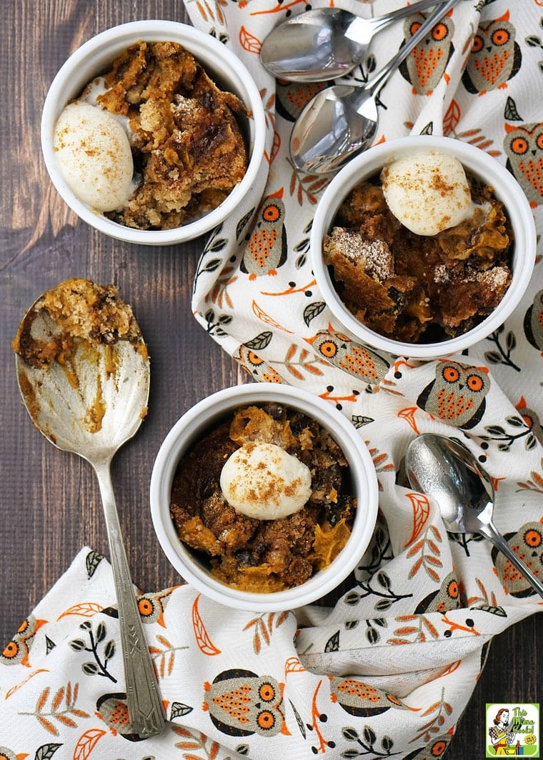 Table top overview of crock-pot pumpkin dump cake with ice cream