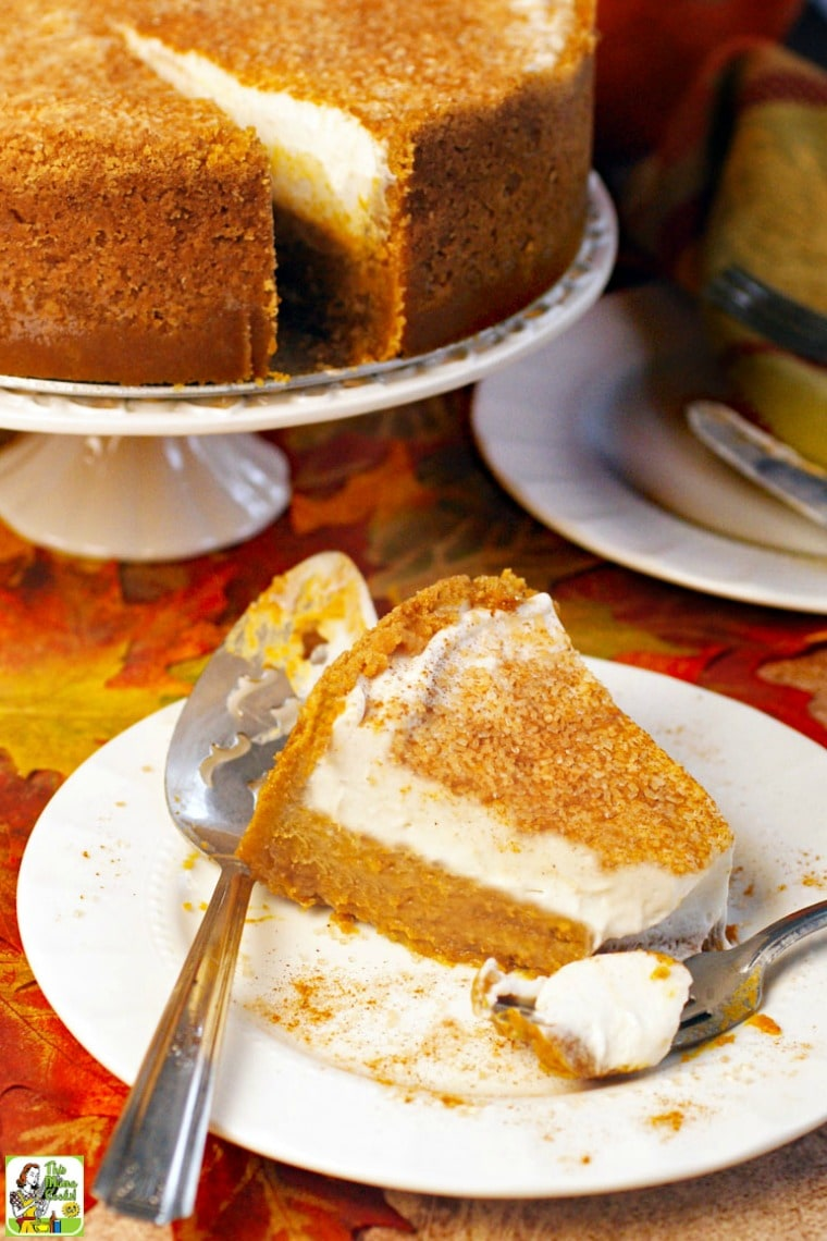A slice of dairy free pumpkin pie on a white plate with serving knife and fork.
