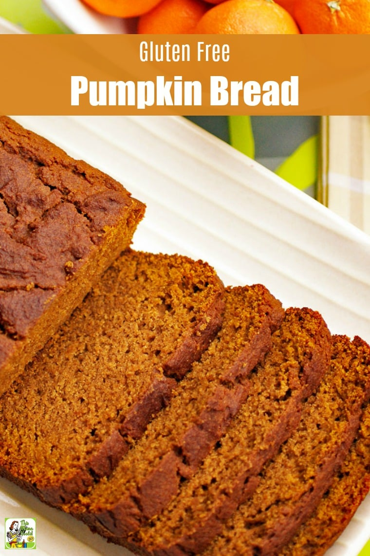 Closeup of a loaf of Pumpkin Bread sliced up on a white plate