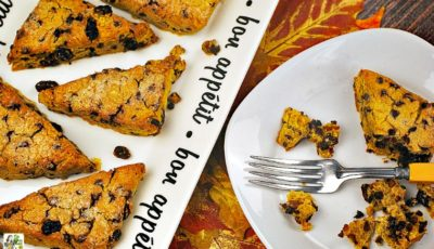 A plate and plate of gluten free scones with pumpkin, raisins, and chocolate chips.