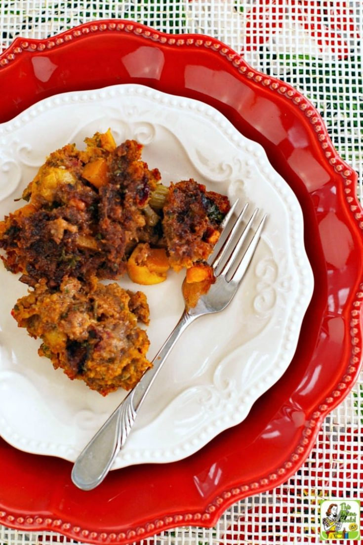 Thanksgiving stuffing with chorizo and squash on white and red plates with a fork.