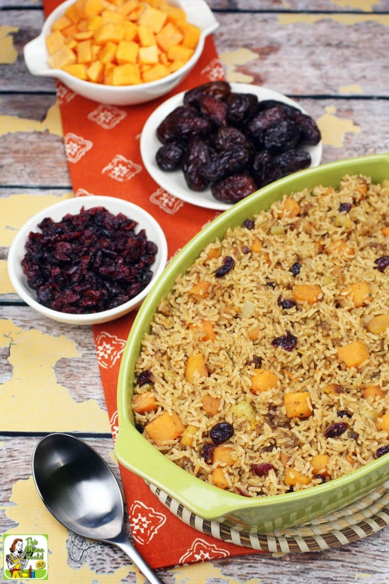 Casserole dish of vegan rice stuffing, bowls of dried fruit, cut butternut squash