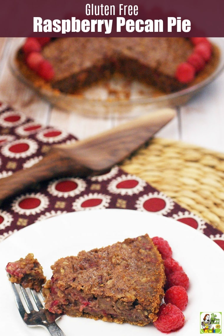 A slice of Raspberry Pecan Pie on a white plate with a fork