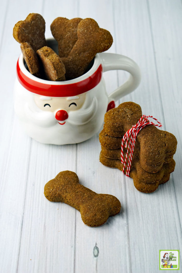 Homemade Dog Treats in a Santa mug and wrapped in red string.