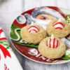 A Christmas plate of Peppermint Thumbprint Hershey Kiss Cookies