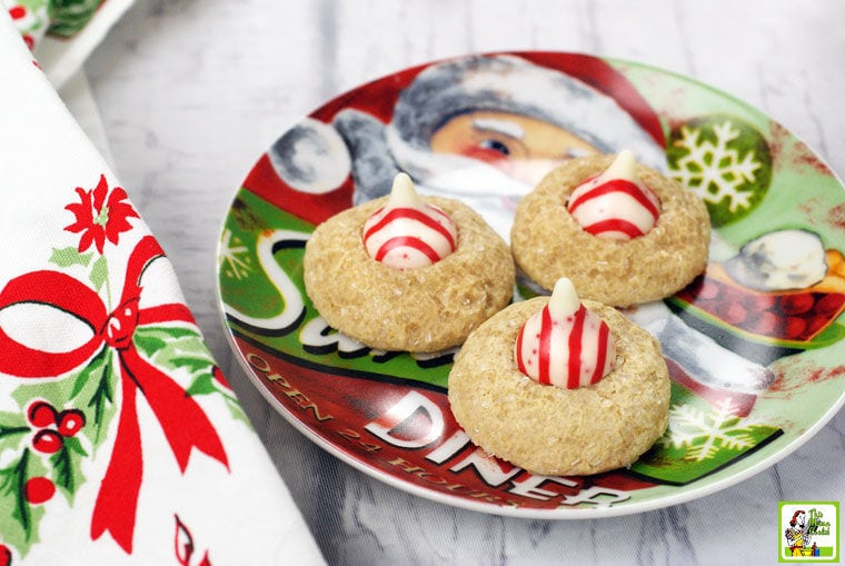 A Christmas plate of Peppermint Thumbprint Hershey Kiss Cookies.