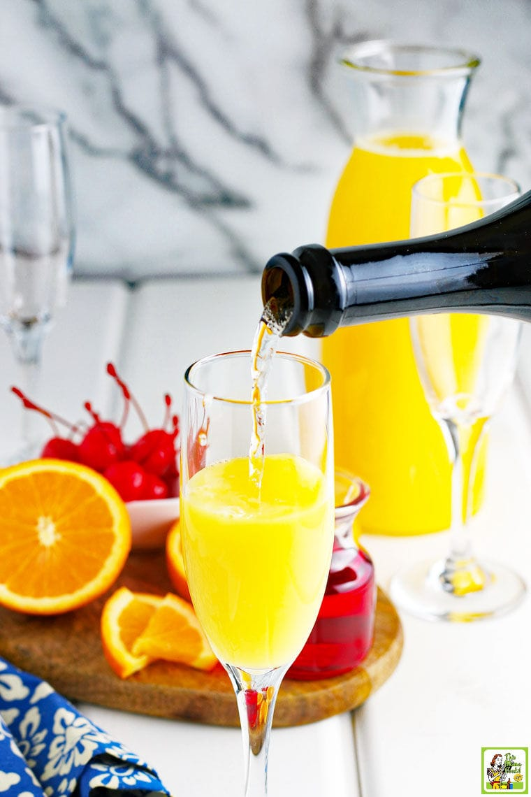 Making Prosecco Mimosas. Pouring sparkling wine or champagne into a glass.