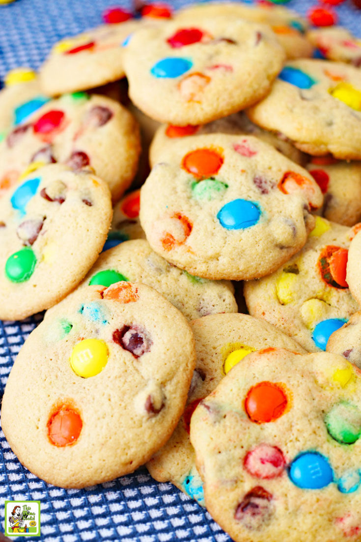 A closeup of a pile of M&M Chocolate Chip Cookies