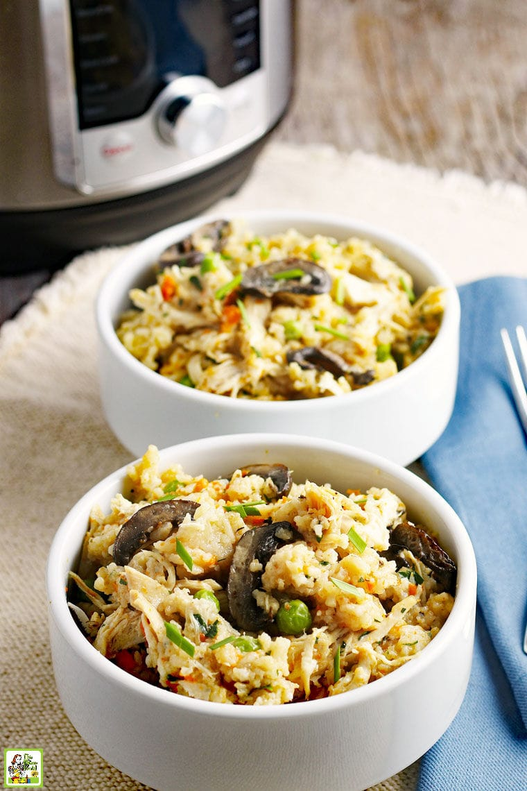 Bowls of chicken, rice, mushrooms, peas and carrots with an Instant Pot pressure cooker in the background