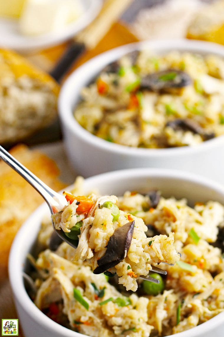 Closeup of a fork of pressure cooker chicken and rice