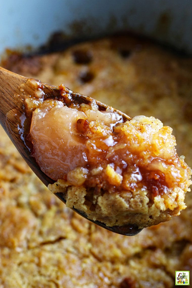 A wooden spoonful of apple cobbler.