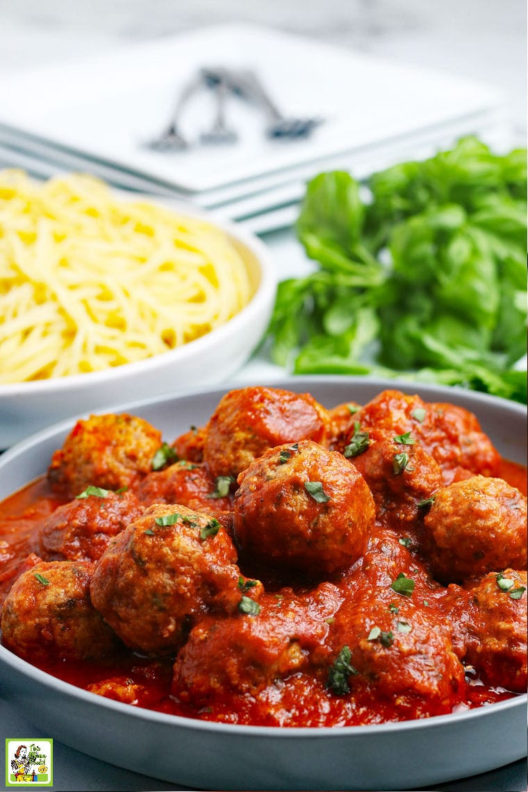 A bowl of cooked turkey meatballs in sauce with pasta.