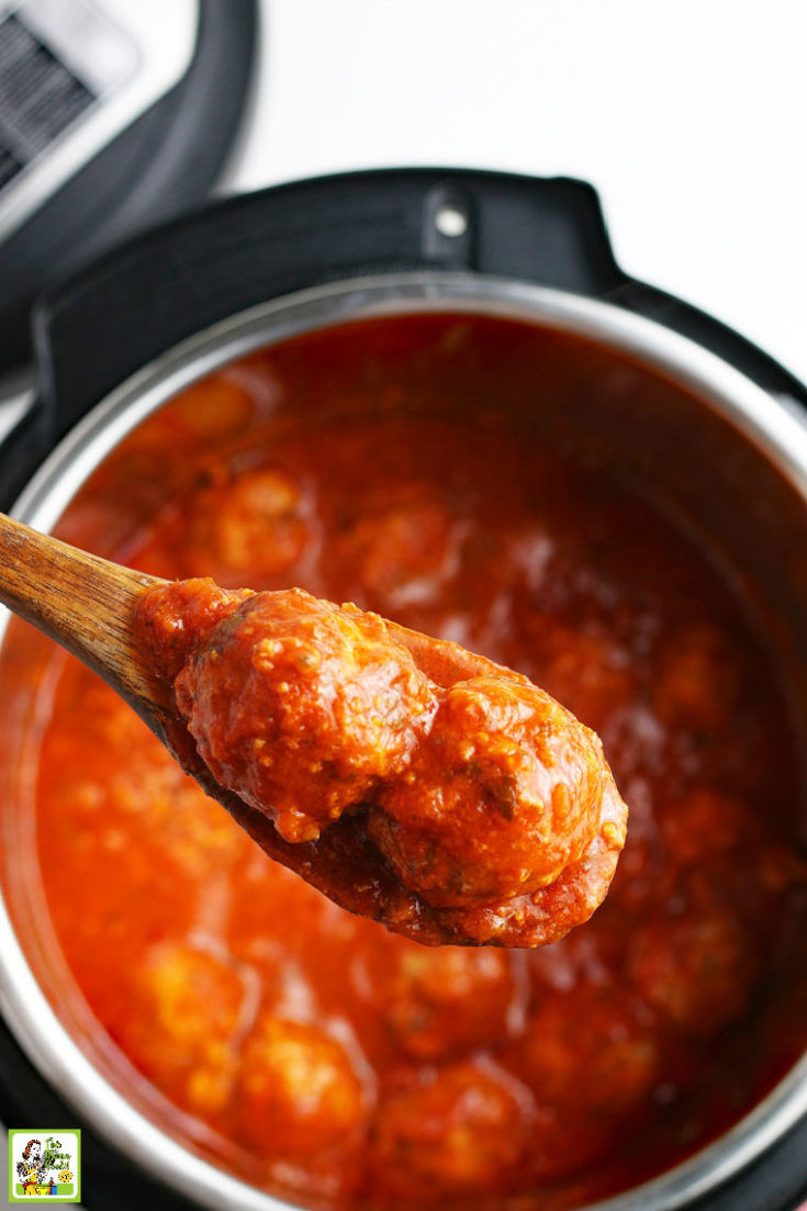 Spooning up meatballs in sauce from a pressure cooker.