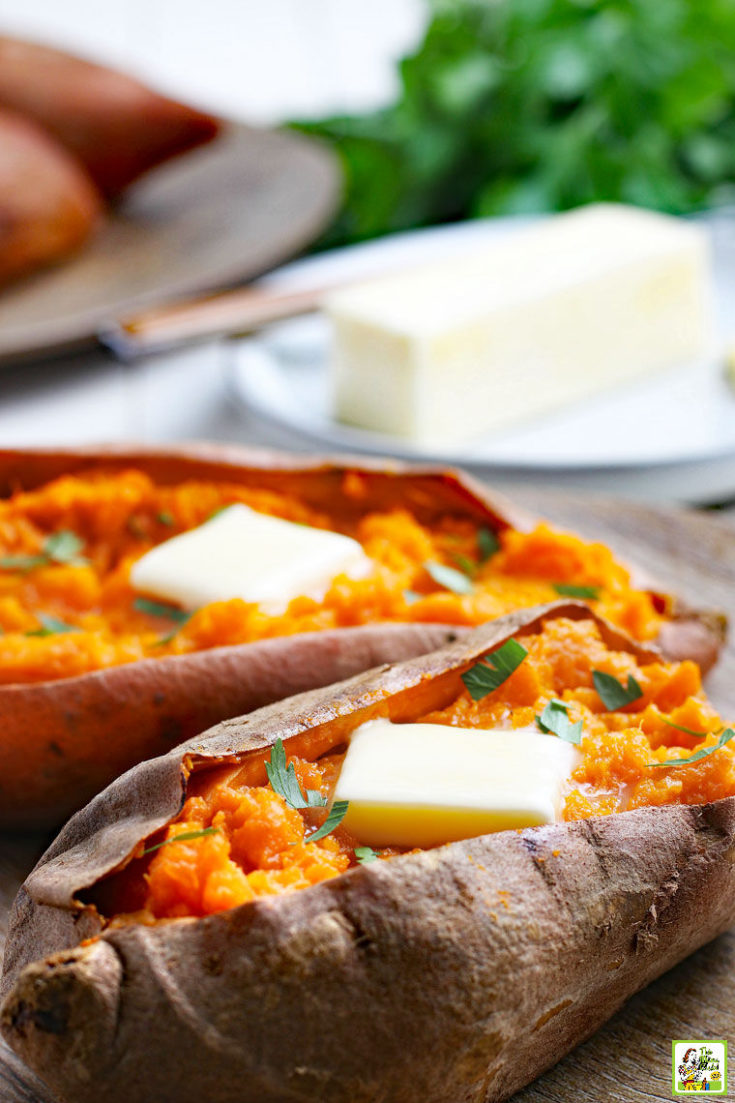Cooked sweet potatoes with pats of butter and a stick of butter in the background.